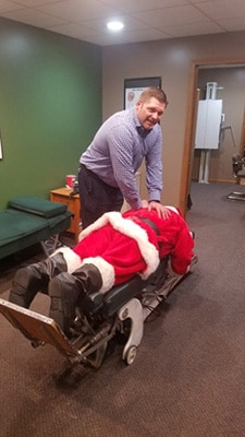 Chiropractor Columbia MO Dr. Scott Stiffey Adjusting Santa