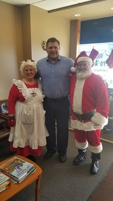 Chiropractor Columbia MO Dr. Scott Stiffey with Santa & Mrs. Claus